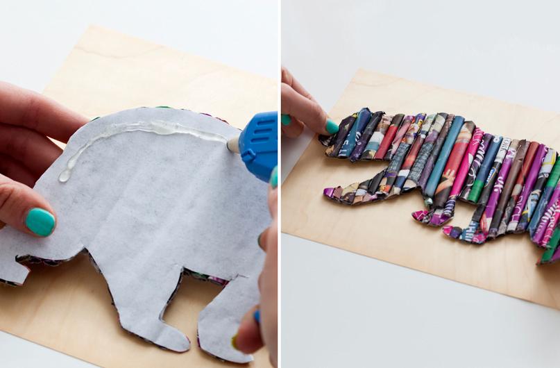 Quando o desenho estiver pronto, cole-o com cola quente no pedaço de madeira.